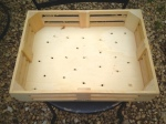 Toy crate with drilled drainage holes