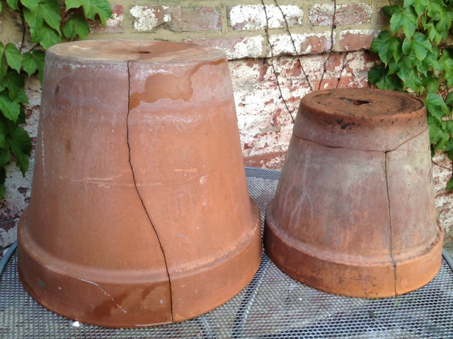 The big pot is cracked but in tact, the medium pot's bottom comes completely off.