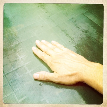 Rubbing oil into table surface by hand