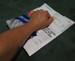 Use your hand to further break up shells, keeping paper edges closed.
