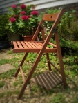 One glued chair is ready for service seating friends in our back yard garden.